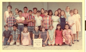The front row is kneeling on coral! That is why I'm in the back. I'm the one with the really crooked bangs.